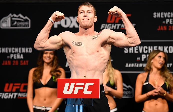 DENVER, COLORADO - JANUARY 27:  J.C. Cottrell poses on the scale during the UFC Fight Night weigh-in at the Pepsi Center on January 27, 2017 in Denver, Colorado. (Photo by Josh Hedges/Zuffa LLC/Zuffa LLC via Getty Images)