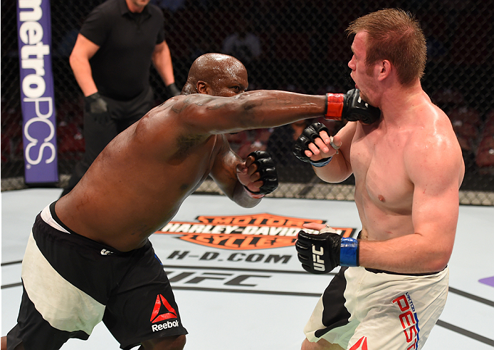 HOUSTON, TX - OCTOBER 03:  (L-R) Derrick Lewis punches Viktor Pesta in their heavyweight bout during the UFC 192 event at the Toyota Center on October 3, 2015 in Houston, Texas. (Photo by Josh Hedges/Zuffa LLC/Zuffa LLC via Getty Images)