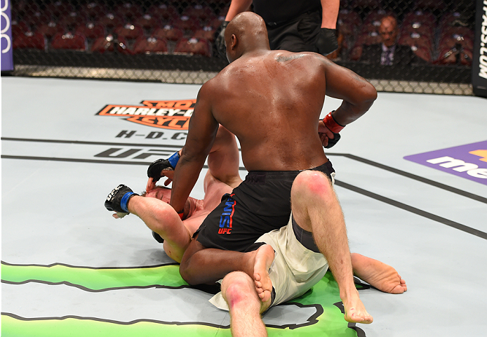 HOUSTON, TX - OCTOBER 03:  Derrick Lewis (top) punches Viktor Pesta in their heavyweight bout during the UFC 192 event at the Toyota Center on October 3, 2015 in Houston, Texas. (Photo by Josh Hedges/Zuffa LLC/Zuffa LLC via Getty Images)
