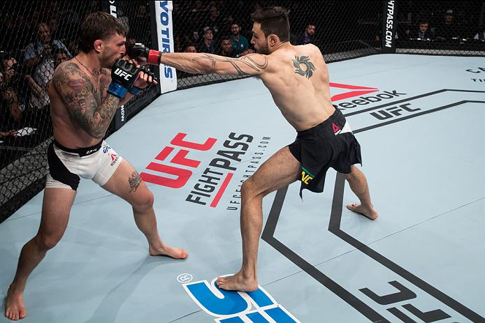 BRASILIA, BRAZIL - SEPTEMBER 24: Glaico Franca of Brazil punches Gregor Gillespie of the United States in their lightweight UFC bout during the UFC Fight Night event at Nilson Nelson gymnasium on September 24, 2016 in Brasilia, Brazil. (Photo by Buda Mendes/Zuffa LLC/Zuffa LLC via Getty Images)