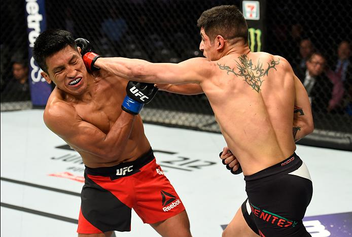 <a href='../fighter/gabriel-benitez'>Gabriel Benitez</a> punches Enrique Barzol during their featherweight matchup at UFC 211