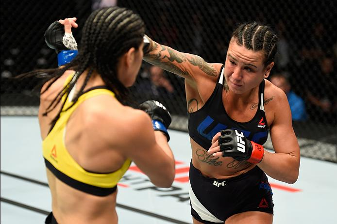KANSAS CITY, MO - APRIL 15:  (R-L) Ashlee Evans-Smith punches Ketlen Vieira of Brazil in their women's bantamweight fight during the UFC Fight Night event at Sprint Center on April 15, 2017 in Kansas City, Missouri. (Photo by Josh Hedges/Zuffa LLC/Zuffa LLC via Getty Images)
