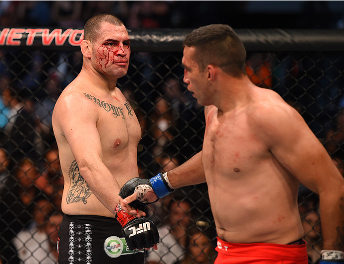 MEXICO CITY, MEXICO - JUNE 13:  (R-L) Cain Velasquez of the United States punches Fabricio Werdum of Brazil in their UFC heavyweight championship bout during the UFC 188 event inside the Arena Ciudad de Mexico on June 13, 2015 in Mexico City, Mexico. (Photo by Jeff Bottari/Zuffa LLC/Zuffa LLC via Getty Images)