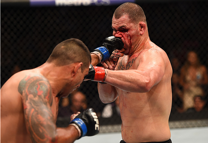 MEXICO CITY, MEXICO - JUNE 13:   (L-R) Fabricio Werdum of Brazil punches Cain Velasquez of the United States in their UFC heavyweight championship bout during the UFC 188 event inside the Arena Ciudad de Mexico on June 13, 2015 in Mexico City, Mexico. (Photo by Josh Hedges/Zuffa LLC/Zuffa LLC via Getty Images)