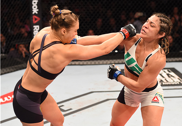 Ronda Rousey of the United States punches Bethe Correia of Brazil in their UFC women's bantamweight championship bout during UFC 190 on August 1, 2015 in Rio de Janeiro, Brazil. (Photo by Josh Hedges/Zuffa LLC)