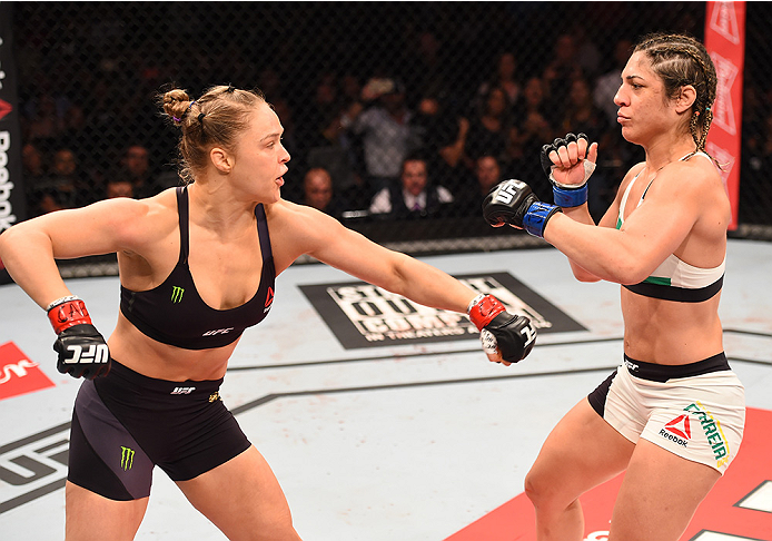 (L-R) Ronda Rousey of the United States throws a punch at Bethe Correia of Brazil in their UFC women's bantamweight championship bout during the UFC 190 event inside HSBC Arena on August 1, 2015 in Rio de Janeiro, Brazil. (Photo by Josh Hedges/Zuffa LLC)