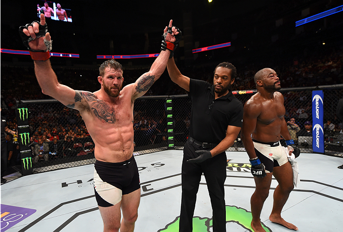 HOUSTON, TX - OCTOBER 03:  (L-R) Ryan Bader celebrates his victory over Rashad Evans in their light heavyweight bout during the UFC 192 event at the Toyota Center on October 3, 2015 in Houston, Texas. (Photo by Josh Hedges/Zuffa LLC/Zuffa LLC via Getty Images)