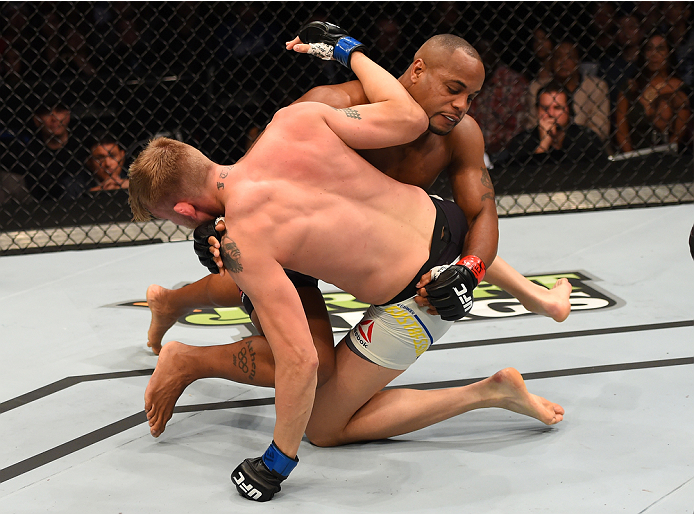 HOUSTON, TX - OCTOBER 03:  (L-R) Daniel Cormier takes down Alexander Gustafsson in their UFC light heavyweight championship bout during the UFC 192 event at the Toyota Center on October 3, 2015 in Houston, Texas. (Photo by Josh Hedges/Zuffa LLC/Zuffa LLC via Getty Images)