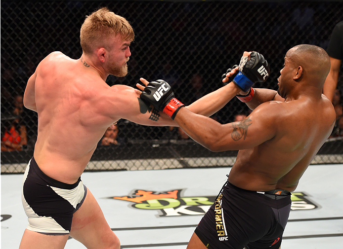 HOUSTON, TX - OCTOBER 03:  (L-R) Alexander Gustafsson punches Daniel Cormier in their UFC light heavyweight championship bout during the UFC 192 event at the Toyota Center on October 3, 2015 in Houston, Texas. (Photo by Josh Hedges/Zuffa LLC/Zuffa LLC via Getty Images)