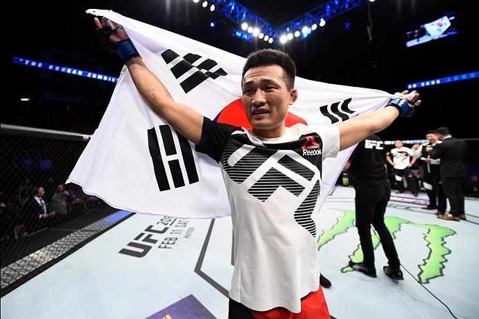 HOUSTON, TX - FEBRUARY 04: <a href='../fighter/Chan-Sung-Jung'>Chan Sung Jung</a> of South Korea celebrates his victory over <a href='../fighter/Dennis-Bermudez'>Dennis Bermudez</a> in their featherweight bout during the <a href='../event/UFC-Silva-vs-Irvin'>UFC Fight Night </a>event at the Toyota Center on February 4, 2017 in Houston, Texas. (Photo by Jeff Bottari/Zuffa LLC via Getty Images)