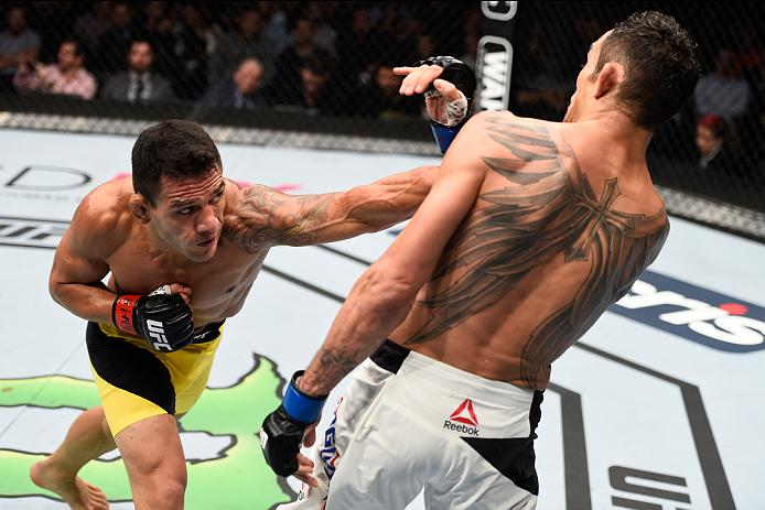 MEXICO CITY, MEXICO - NOVEMBER 05:  (L-R) Rafael Dos Anjos of Brazil punches Tony Ferguson of the United States in their lightweight bout during the UFC Fight Night event at Arena Ciudad de Mexico on November 5, 2016 in Mexico City, Mexico. (Photo by Jeff Bottari/Zuffa LLC/Zuffa LLC via Getty Images)