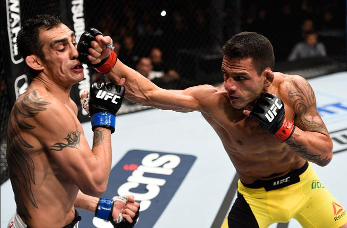 MEXICO CITY, MEXICO - NOVEMBER 05:  (R-L) Rafael Dos Anjos of Brazil punches Tony Ferguson of the United States in their lightweight bout during the UFC Fight Night event at Arena Ciudad de Mexico on November 5, 2016 in Mexico City, Mexico. (Photo by Jeff Bottari/Zuffa LLC/Zuffa LLC via Getty Images)