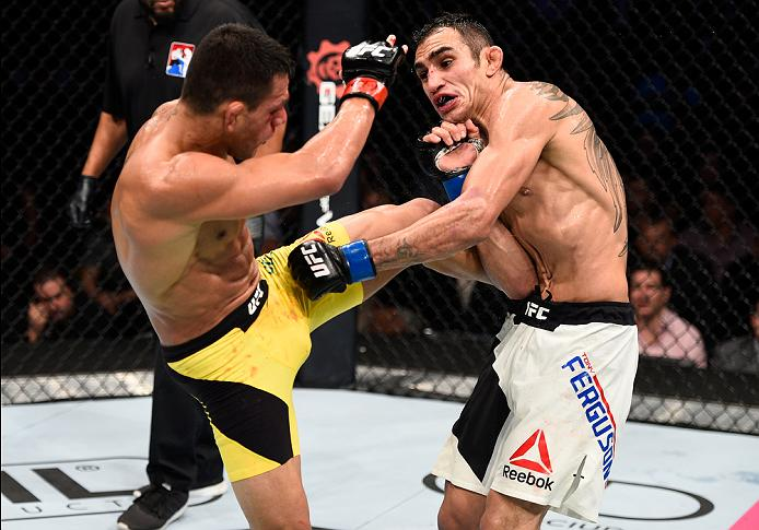 MEXICO CITY, MEXICO - NOVEMBER 05:  (L-R) Rafael Dos Anjos of Brazil kicks Tony Ferguson of the United States in their lightweight bout during the UFC Fight Night event at Arena Ciudad de Mexico on November 5, 2016 in Mexico City, Mexico. (Photo by Jeff Bottari/Zuffa LLC/Zuffa LLC via Getty Images)