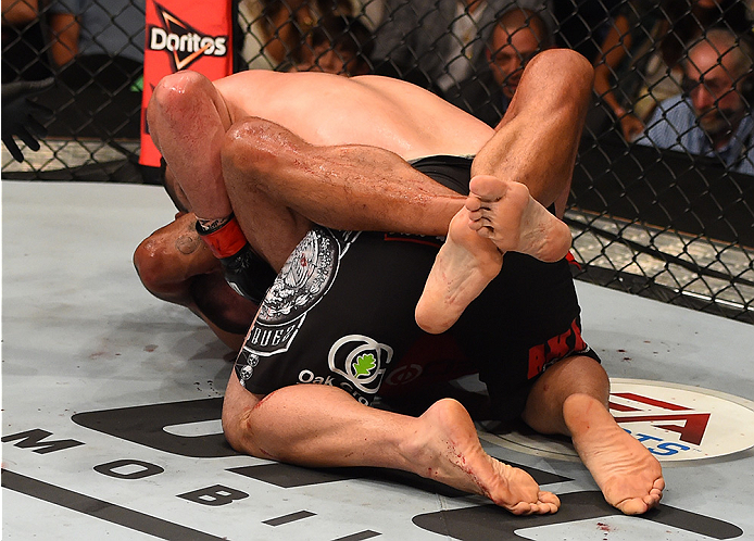 MEXICO CITY, MEXICO - JUNE 13:   Fabricio Werdum of Brazil submits Cain Velasquez of the United States in their UFC heavyweight championship bout during the UFC 188 event inside the Arena Ciudad de Mexico on June 13, 2015 in Mexico City, Mexico. (Photo by Josh Hedges/Zuffa LLC/Zuffa LLC via Getty Images)