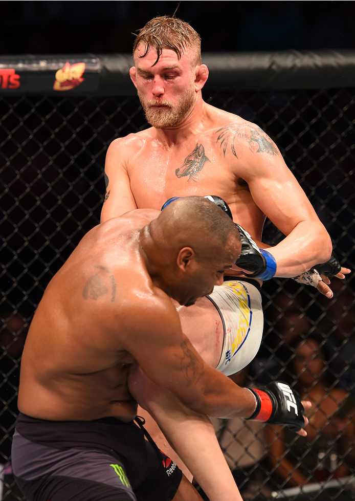 HOUSTON, TX - OCTOBER 03:  (R-L) Alexander Gustafsson knees Daniel Cormier in their UFC light heavyweight championship bout during the UFC 192 event at the Toyota Center on October 3, 2015 in Houston, Texas. (Photo by Josh Hedges/Zuffa LLC/Zuffa LLC via Getty Images)