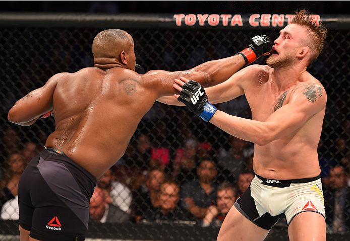 HOUSTON, TX - OCTOBER 03:  (L-R) Daniel Cormier punches Alexander Gustafsson in their UFC light heavyweight championship bout during the UFC 192 event at the Toyota Center on October 3, 2015 in Houston, Texas. (Photo by Josh Hedges/Zuffa LLC/Zuffa LLC via Getty Images)