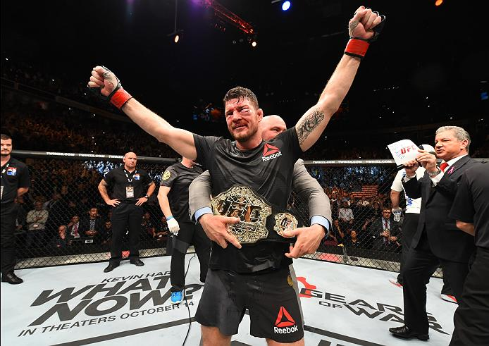 <a href='../fighter/Michael-Bisping'>Michael Bisping</a> celebrates after defending his middleweight title against <a href='../fighter/Dan-Henderson'>Dan Henderson</a> at UFC 204