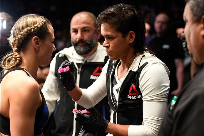 PHOENIX, AZ - JANUARY 15:  (L-R) Nina Ansaroff gets her mouthpiece from Amanda Nunes in their women's strawweight bout during the UFC Fight Night event inside Talking Stick Resort Arena on January 15, 2017 in Phoenix, Arizona. (Photo by Jeff Bottari/Zuffa LLC/Zuffa LLC via Getty Images)