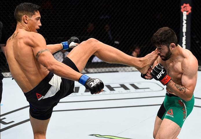 MEXICO CITY, MEXICO - NOVEMBER 05:  (L-R) Jason Novelli of the United States kicks Marco Polo Reyes of Mexico in their lightweight bout during the UFC Fight Night event at Arena Ciudad de Mexico on November 5, 2016 in Mexico City, Mexico. (Photo by Jeff Bottari/Zuffa LLC/Zuffa LLC via Getty Images)
