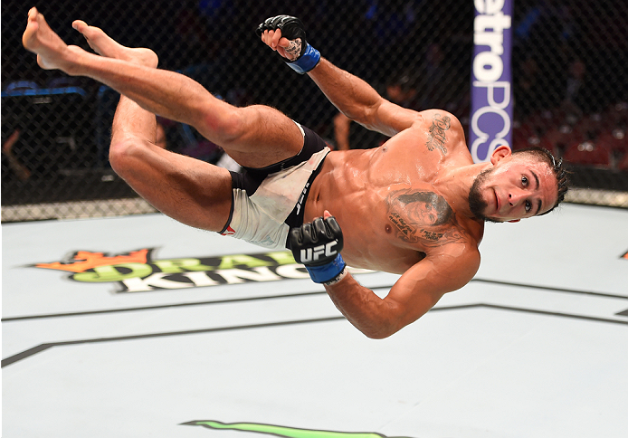 HOUSTON, TX - OCTOBER 03:  Sergio Pettis does a flip in the Octagon after facing Chris Cariaso in their flyweight bout during the UFC 192 event at the Toyota Center on October 3, 2015 in Houston, Texas. (Photo by Josh Hedges/Zuffa LLC/Zuffa LLC via Getty Images)