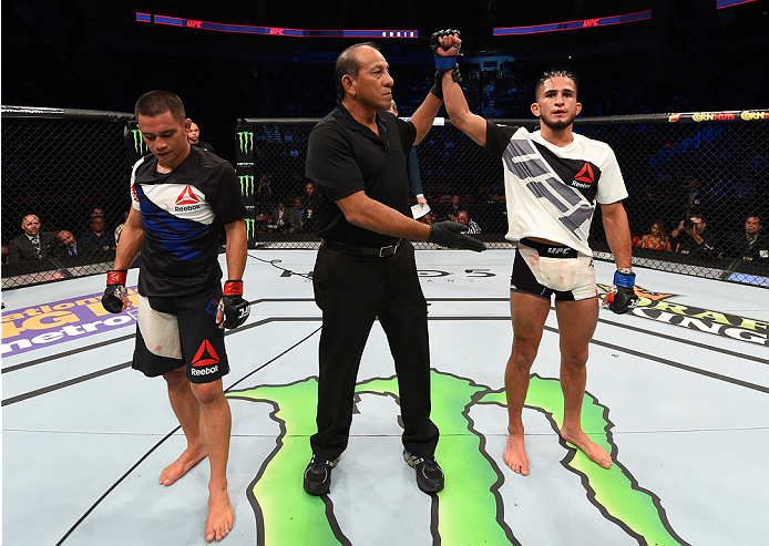 HOUSTON, TX - OCTOBER 03:  (R-L) Sergio Pettis celebrates his victory over Chris Cariaso in their flyweight bout during the UFC 192 event at the Toyota Center on October 3, 2015 in Houston, Texas. (Photo by Josh Hedges/Zuffa LLC/Zuffa LLC via Getty Images)
