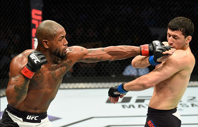 KANSAS CITY, MO - APRIL 15:  (L-R) Bobby Green punches Rashid Magomedov of Russia in their lightweight fight during the UFC Fight Night event at Sprint Center on April 15, 2017 in Kansas City, Missouri. (Photo by Josh Hedges/Zuffa LLC/Zuffa LLC via Getty Images)