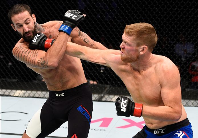 MEXICO CITY, MEXICO - NOVEMBER 05:  (R-L) Sam Alvey of the United States punches Alex Nicholson of the United States in their middleweight bout during the UFC Fight Night event at Arena Ciudad de Mexico on November 5, 2016 in Mexico City, Mexico. (Photo by Jeff Bottari/Zuffa LLC/Zuffa LLC via Getty Images)