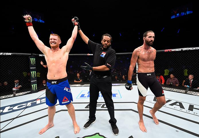 MEXICO CITY, MEXICO - NOVEMBER 05:  (L-R) Sam Alvey of the United States celebrates his victory over Alex Nicholson of the United States in their middleweight bout during the UFC Fight Night event at Arena Ciudad de Mexico on November 5, 2016 in Mexico City, Mexico. (Photo by Jeff Bottari/Zuffa LLC/Zuffa LLC via Getty Images)