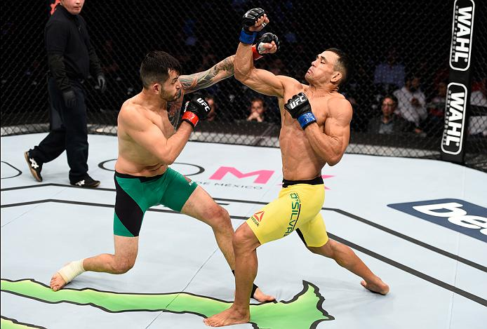 MEXICO CITY, MEXICO - NOVEMBER 05:  (R-L) Douglas Silva de Andrade of Brazil exchanges punches with Henry Briones of Mexico in their bantamweight bout during the UFC Fight Night event at Arena Ciudad de Mexico on November 5, 2016 in Mexico City, Mexico. (Photo by Jeff Bottari/Zuffa LLC/Zuffa LLC via Getty Images)
