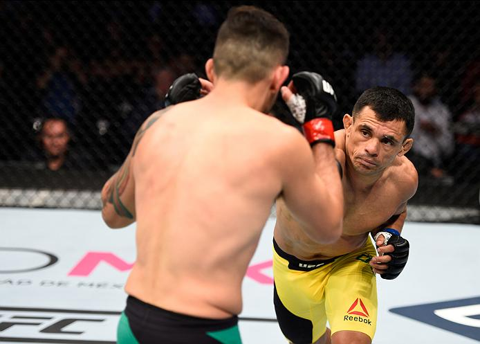 MEXICO CITY, MEXICO - NOVEMBER 05:  (R-L) Douglas Silva de Andrade of Brazil punches Henry Briones of Mexico in their bantamweight bout during the UFC Fight Night event at Arena Ciudad de Mexico on November 5, 2016 in Mexico City, Mexico. (Photo by Jeff Bottari/Zuffa LLC/Zuffa LLC via Getty Images)