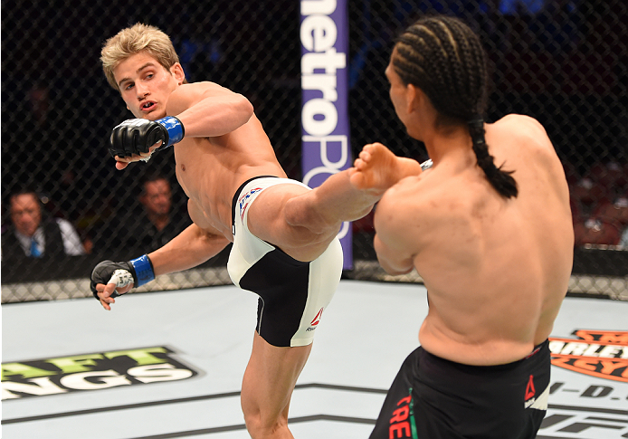 HOUSTON, TX - OCTOBER 03:  (L-R) Sage Northcutt kicks Francisco Trevino in their lightweight bout during the UFC 192 event at the Toyota Center on October 3, 2015 in Houston, Texas. (Photo by Josh Hedges/Zuffa LLC/Zuffa LLC via Getty Images)