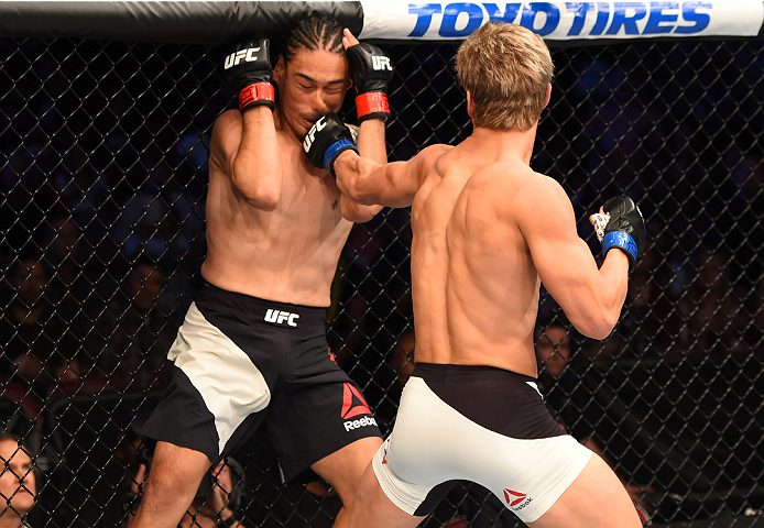 HOUSTON, TX - OCTOBER 03:  (R-L) Sage Northcutt punches Francisco Trevino in their lightweight bout during the UFC 192 event at the Toyota Center on October 3, 2015 in Houston, Texas. (Photo by Josh Hedges/Zuffa LLC/Zuffa LLC via Getty Images)