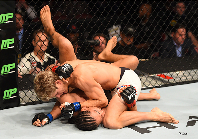 HOUSTON, TX - OCTOBER 03:  Sage Northcutt (top) elbows Francisco Trevino in their lightweight bout during the UFC 192 event at the Toyota Center on October 3, 2015 in Houston, Texas. (Photo by Josh Hedges/Zuffa LLC/Zuffa LLC via Getty Images)