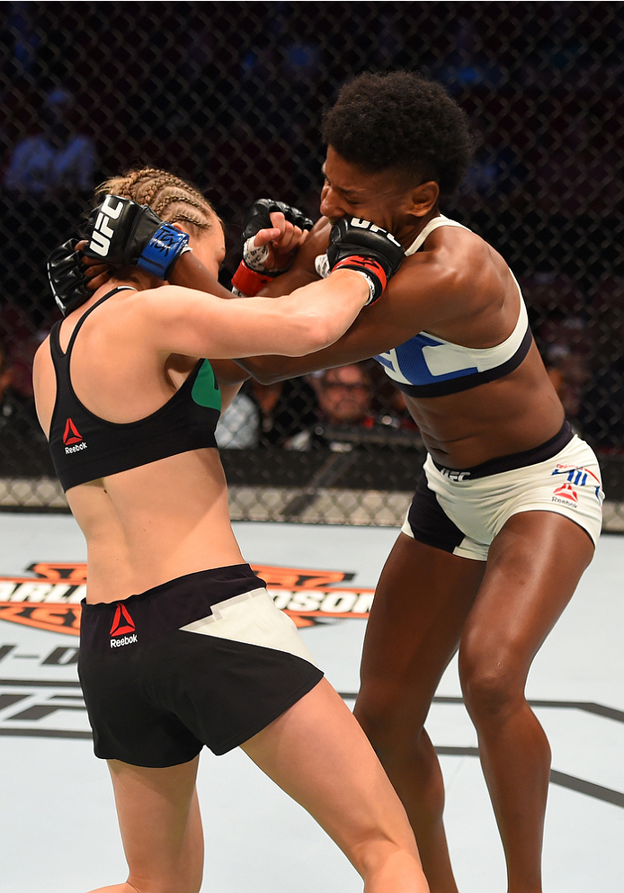 HOUSTON, TX - OCTOBER 03:  (L-R) Rose Namajunas punches Angela Hill in their women's strawweight bout during the UFC 192 event at the Toyota Center on October 3, 2015 in Houston, Texas. (Photo by Josh Hedges/Zuffa LLC/Zuffa LLC via Getty Images)