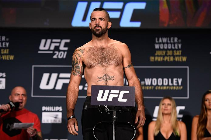 ATLANTA, GA - JULY 29:  Matt Brown steps on the scale during the UFC 201 weigh-in at Fox Theatre on July 29, 2016 in Atlanta, Georgia. (Photo by Jeff Bottari/Zuffa LLC/Zuffa LLC via Getty Images)