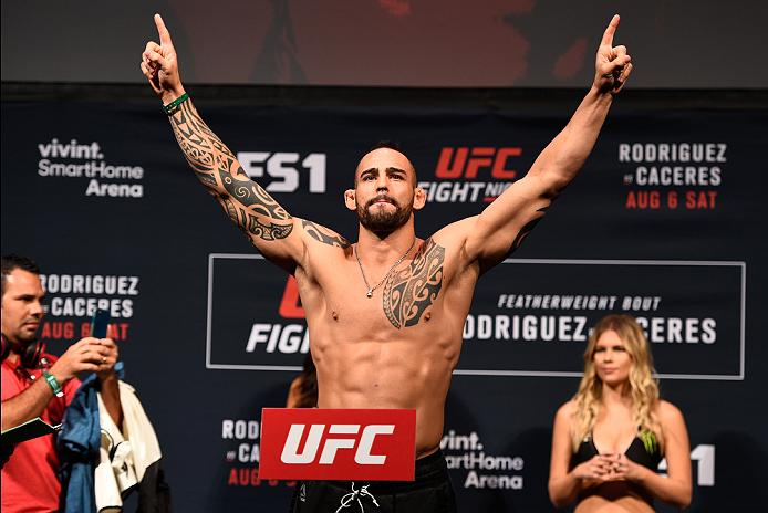 SALT LAKE CITY, UT - AUGUST 05:  Santiago Ponzinibbio of Argentina steps on the scale during the UFC weigh-in at Vivint Smart Home Arena on August 5, 2016 in Salt Lake City, Utah. (Photo by Jeff Bottari/Zuffa LLC/Zuffa LLC via Getty Images)