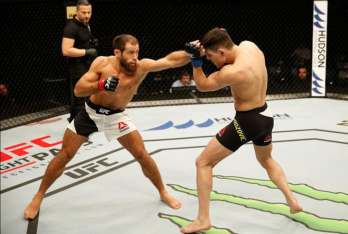 ZAGREB, CROATIA - APRIL 10:   (L-R) Mairbek Taisumov punches Damir Hadzovic in their lightweight bout during the UFC Fight Night event at the Arena Zagreb on April 10, 2016 in Zagreb, Croatia. (Photo by Srdjan Stevanovic/Zuffa LLC/Zuffa LLC via Getty Images)