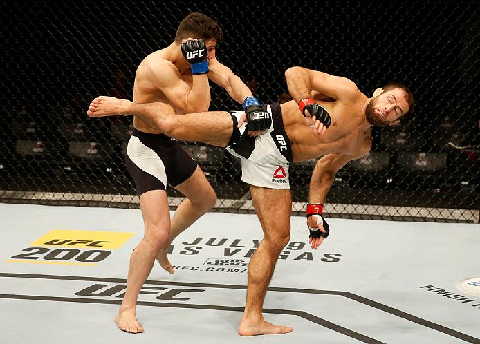 ZAGREB, CROATIA - APRIL 10:   (R-L) Mairbek Taisumov kicks Damir Hadzovic in their lightweight bout during the UFC Fight Night event at the Arena Zagreb on April 10, 2016 in Zagreb, Croatia. (Photo by Srdjan Stevanovic/Zuffa LLC/Zuffa LLC via Getty Images)