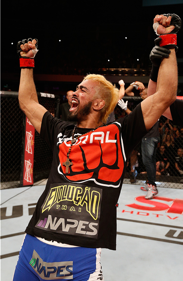 BRASILIA, BRAZIL - SEPTEMBER 13: Godofredo Pepey of Brazil celebrates after his submission victory over Dashon Johnson in their featherweight bout during the UFC Fight Night event inside Nilson Nelson Gymnasium on September 13, 2014 in Brasilia, Brazil. (Photo by Josh Hedges/Zuffa LLC/Zuffa LLC via Getty Images)