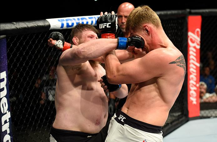 KANSAS CITY, MO - APRIL 15:  (L-R) Roy Nelson punches Alexander Volkov of Russia in their heavyweight fight during the UFC Fight Night event at Sprint Center on April 15, 2017 in Kansas City, Missouri. (Photo by Josh Hedges/Zuffa LLC/Zuffa LLC via Getty Images)