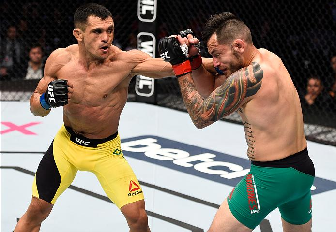 MEXICO CITY, MEXICO - NOVEMBER 05:  (L-R) Douglas Silva de Andrade of Brazil punches Henry Briones of Mexico in their bantamweight bout during the UFC Fight Night event at Arena Ciudad de Mexico on November 5, 2016 in Mexico City, Mexico. (Photo by Jeff Bottari/Zuffa LLC/Zuffa LLC via Getty Images)