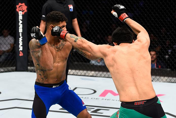 MEXICO CITY, MEXICO - NOVEMBER 05:  (R-L) Erick Montano of Mexico punches Max Griffin of the United States in their welterweight bout during the UFC Fight Night event at Arena Ciudad de Mexico on November 5, 2016 in Mexico City, Mexico. (Photo by Jeff Bottari/Zuffa LLC/Zuffa LLC via Getty Images)