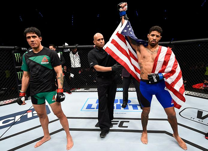 MEXICO CITY, MEXICO - NOVEMBER 05:  (R-L) Max Griffin of the United States celebrates his victory over Erick Montano of Mexico in their welterweight bout during the UFC Fight Night event at Arena Ciudad de Mexico on November 5, 2016 in Mexico City, Mexico. (Photo by Jeff Bottari/Zuffa LLC/Zuffa LLC via Getty Images)