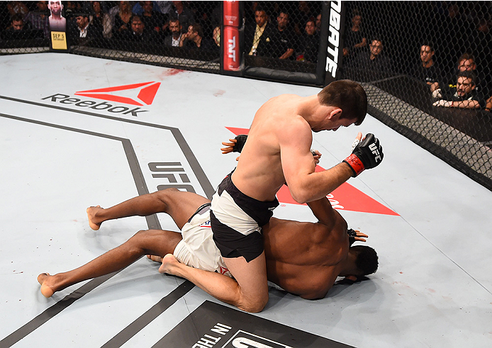 Demian Maia of Brazil (top) punches Neil Magny of the United States in their welterweight bout during UFC 190 on August 1, 2015 in Rio de Janeiro, Brazil. (Photo by Josh Hedges/Zuffa LLC)