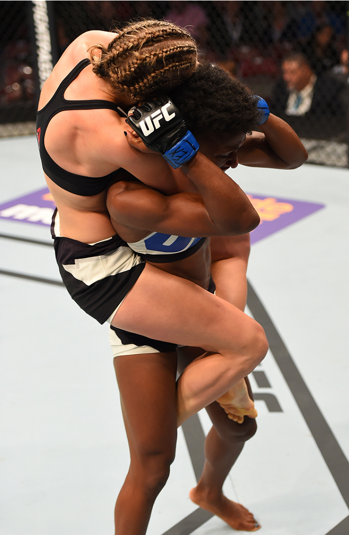 HOUSTON, TX - OCTOBER 03:  (L-R) Rose Namajunas attempts to submit Angela Hill in their women's strawweight bout during the UFC 192 event at the Toyota Center on October 3, 2015 in Houston, Texas. (Photo by Josh Hedges/Zuffa LLC/Zuffa LLC via Getty Images)