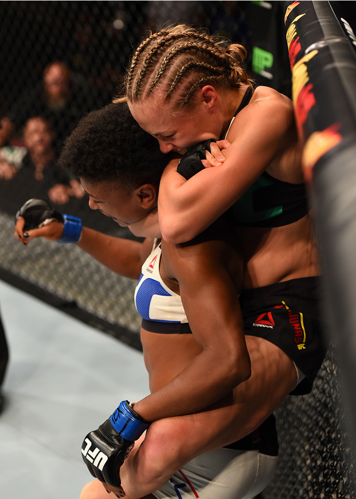HOUSTON, TX - OCTOBER 03:  (R-L) Rose Namajunas submits Angela Hill in their women's strawweight bout during the UFC 192 event at the Toyota Center on October 3, 2015 in Houston, Texas. (Photo by Josh Hedges/Zuffa LLC/Zuffa LLC via Getty Images)