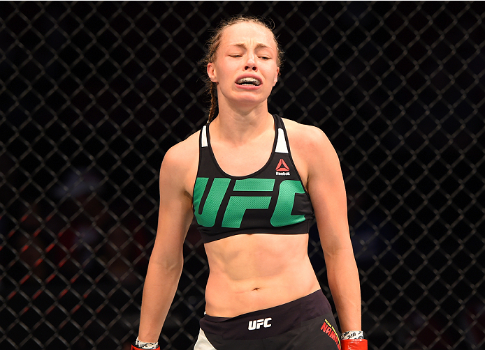 HOUSTON, TX - OCTOBER 03:  Rose Namajunas celebrates her submission victory over Angela Hill in their women's strawweight bout during the UFC 192 event at the Toyota Center on October 3, 2015 in Houston, Texas. (Photo by Josh Hedges/Zuffa LLC/Zuffa LLC via Getty Images)