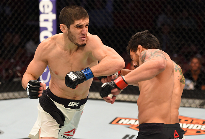 HOUSTON, TX - OCTOBER 03:  (L-R) Islam Makhachev elbows Adriano Martins in their lightweight bout during the UFC 192 event at the Toyota Center on October 3, 2015 in Houston, Texas. (Photo by Josh Hedges/Zuffa LLC/Zuffa LLC via Getty Images)