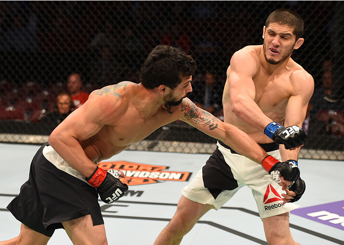 HOUSTON, TX - OCTOBER 03:  (L-R) Adriano Martins punches Islam Makhachev in their lightweight bout during the UFC 192 event at the Toyota Center on October 3, 2015 in Houston, Texas. (Photo by Josh Hedges/Zuffa LLC/Zuffa LLC via Getty Images)