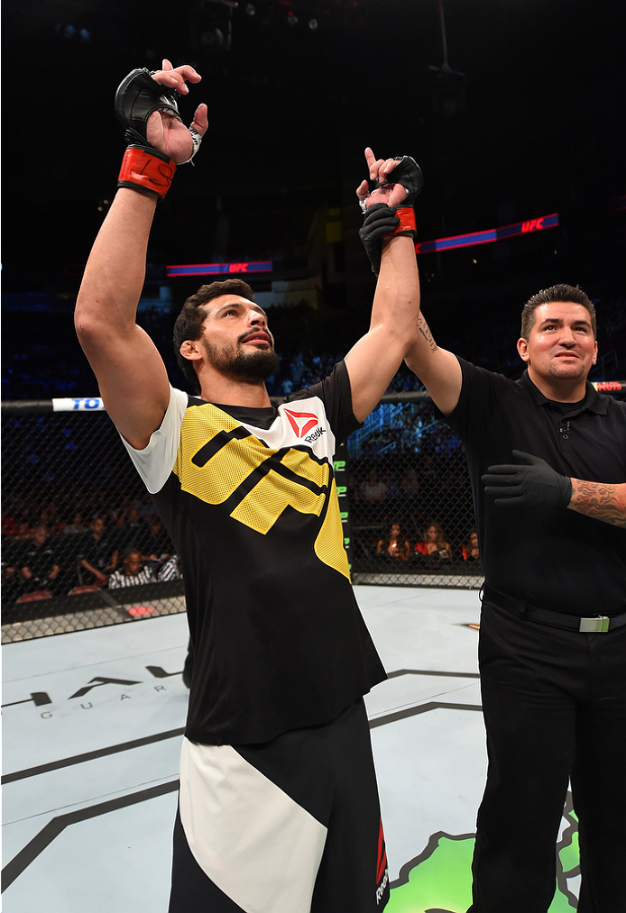 HOUSTON, TX - OCTOBER 03:  Adriano Martins celebrates his knockout victory over Islam Makhachev in their lightweight bout during the UFC 192 event at the Toyota Center on October 3, 2015 in Houston, Texas. (Photo by Josh Hedges/Zuffa LLC/Zuffa LLC via Getty Images)